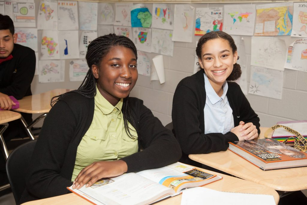 Two DBCR students smiling in classroom