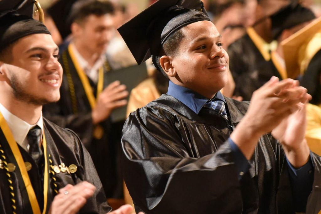 DBCR students clapping at graduation ceremony